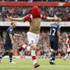 Cesc Fabregas celebrates Arsenal's smashing win